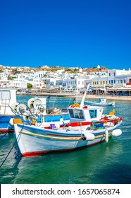 Traditional fishing boats moored in the old port of Mykonos island in Greece