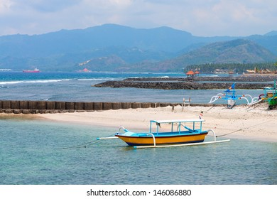 Traditional fishing boats on a beach in Candidasa on Bali, Indonesia.