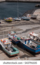 Traditional fishing boats parked on the docks in Sao Miguel, Azores, Portugal.