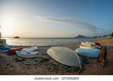 Traditional fishing boats towed ashore with vintage machinery on Altea Bay, Costa Blanca, Spain