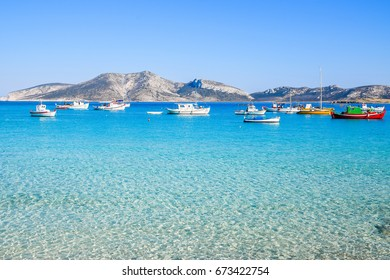Traditional fishing boats in turquoise waters at Koufonisia, Small Cyclades, Greece