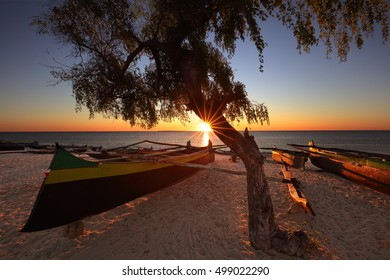 Traditional fishing pirogue on the beach at sunset in Anakao, Madagascar