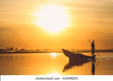 Traditional fishing pirogue at sunset on the Tsiribihina river in Madagascar