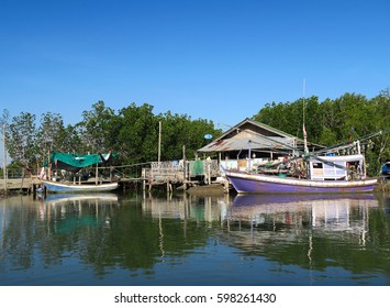 Traditional fishing sailing boats in a village in Thailand