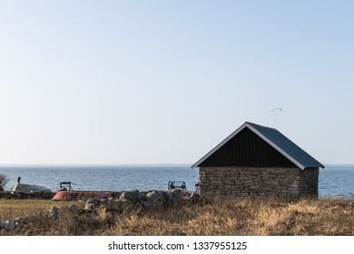 Traditional fishing site with cabin built of limestone at the swedish island Oland in the Baltic Sea
