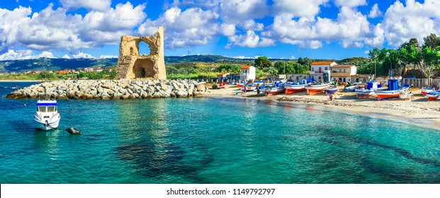 Traditional fishing village Briatico in Calabria with turquoise sea and old saracen tower. Italy