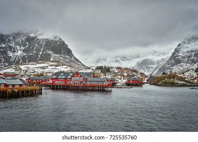 Traditional fishing village A i Lofoten. Lofoten Islands, Norway with red rorbu houses. With snow in winter