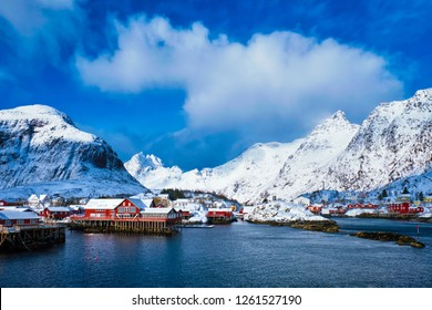 Traditional fishing village A on Lofoten Islands, Norway with red rorbu houses. With snow in winter