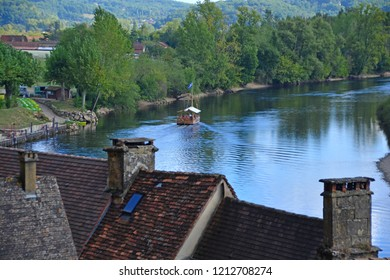 A traditional flat bottomed Scow, known locally as a Gabarre on the River Dordogne, France. Used for water transport in shallow waters