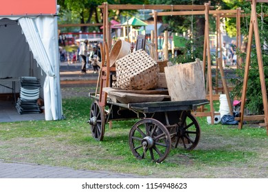 Traditional folk craftsmen market. Old horse carts with various craftsmen products.