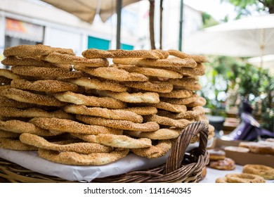 Traditional food concept.  Tray full of Greek traditional round sesame bread rings, displayed in a street market with bokeh background.