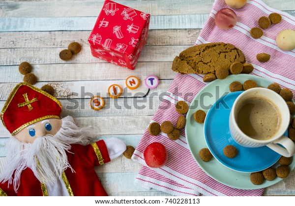 traditional food for Dutch event Sinterklaas, with doll, gift, coffee and ginger nuts