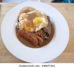 Traditional food in Hawaii called Loco Moco consists of white rice topped with fried eggs, hamburger platter, spam, and brown gravy