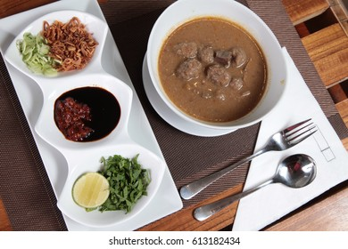 traditional food from makassar indonesia named coto with hrebs and spices