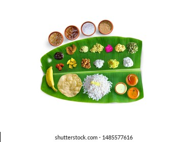 Traditional food Onam Sadya served on a banana leaf on Festival day onam,  Vegetarian meal with rice and curries, kerala food, Kerala, india