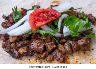 Traditional food of Sanliurfa grilled lamp livers badded with lavash