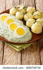 Traditional Frankfurter Gruene Sosse greensauce with boiled potatoes and eggs close-up in a plate. vertical - Shutterstock ID 1840734718
