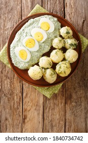 Traditional Frankfurter Gruene Sosse greensauce with boiled potatoes and eggs close-up in a plate. vertical top view from above - Shutterstock ID 1840734742