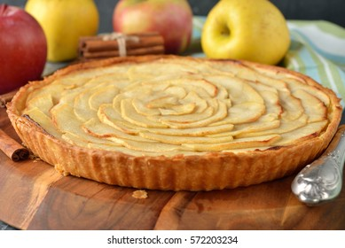 Traditional French apple tart on a gray background