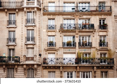 Traditional French Architecture with Typical Windows and Balconies in Paris, France. Haussmann's renovation of Paris Houses.
