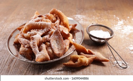 traditional french bugne- donut with sugar