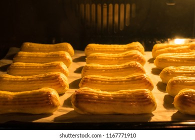 Traditional French eclairs, baking and growth in the oven.