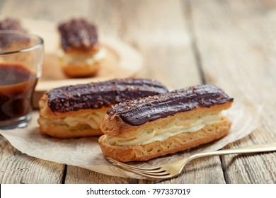 Traditional french eclairs with chocolate.