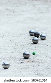 The traditional French game of Petanque boule and cochonnet on gravel playing surface