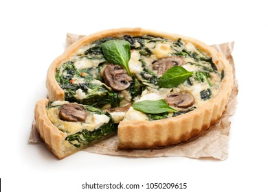 Traditional  french quiche pie with spinach and mushroom isolated on white
