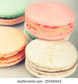 Traditional French sweets Macarons with retro filter effect