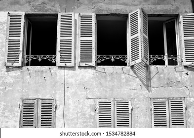 Traditional French window with open shutters souther France