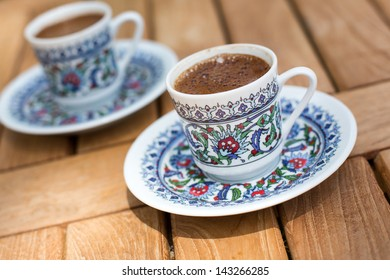 Traditional fresh brewed turkish coffee on wooden table