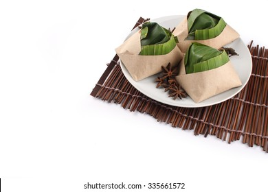 traditional fresh Malaysian nasi lemak packed with banana leaf in white background
