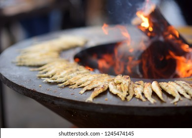 Traditional fried fish being cooked at the spring market in Vilnius, Lithuania. Variety tasty street food on Easter fair.