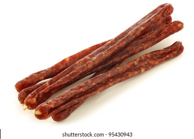 traditional frisian dried sausage sticks on a white background