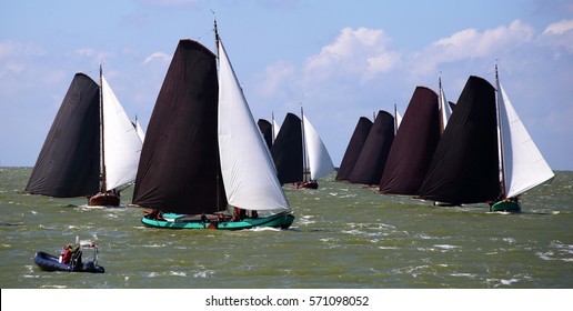 Traditional Frisian wooden sailing ships in a yearly competition on the Ijsselmeer, The Netherlands