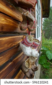 traditional fur boots of sami people hanging on a wall