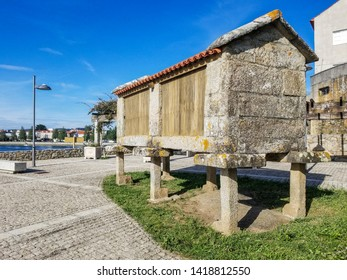 Traditional galician horreo barn decoratin a urban square in Cambados city