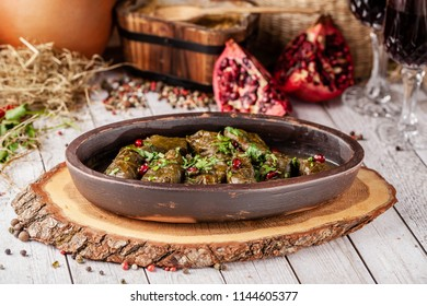 "Traditional Georgian and Armenian cuisine. The dish ""Dolma"". Cabbage rolls of grape leaves with rice and minced meat. Copy space, selective focus"