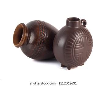 traditional Georgian ceramic utensils (chinchila, kvevri) for wine on a white background.