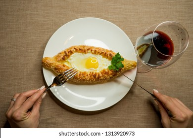 Traditional Georgian dish - khachapuri, bread with egg