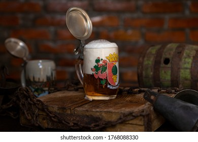 Traditional German beer stein with a silver lid - Shutterstock ID 1768088330