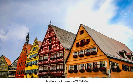 Traditional German buildings painted in beautiful bright colors. Taken on a sunny, summer day in Dinkelsbühl, Bavaria, Germany