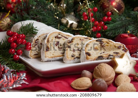 traditional german christmas cake cranberry stollen christmas tree ornaments and candles