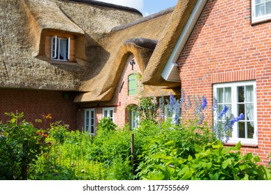 Traditional German Cottage in Friesland Germany with Thatched Roof
