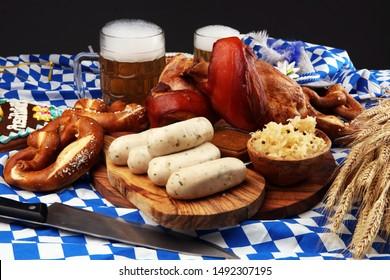 Traditional German cuisine, Schweinshaxe roasted ham hock. Beer, pretzels and various Bavarian specialties. Oktoberfest background