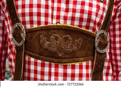 Traditional German Lederhosen Center Chestpiece Closeup Leather Plaid Dress Red White