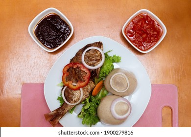 Traditional Ghanaian cuisine, Banku with fried tilapia and hot sauce