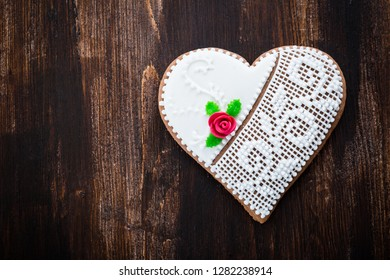 Traditional gingerbread heart cookie on wooden background