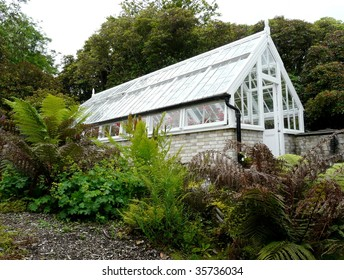 Traditional glass greenhouse or hothouse